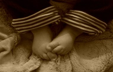 A sepia photograph of some small baby feet _ An open letter to our first baby _ Mrs H's favourite things