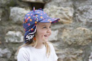 Girl wearing navy sun hat by Little Hotdog Watson