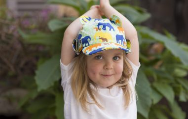 Girl wearing Little Hotdog Watson elephant sun hat