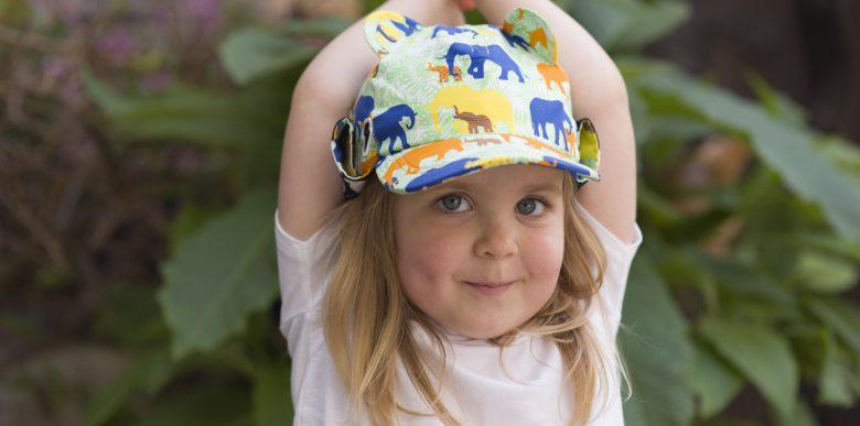 Girl wearing Little Hotdog Watson elephant sun hat