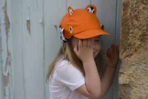 Girl wearing orange sun hat by Little Hotdog Watson